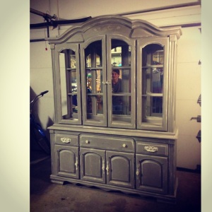 This old brown china cabinet was painted with Annie Sloan French Linen with Old White distressed accents.